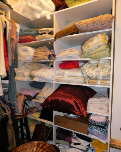 pillows and bedding on shelves